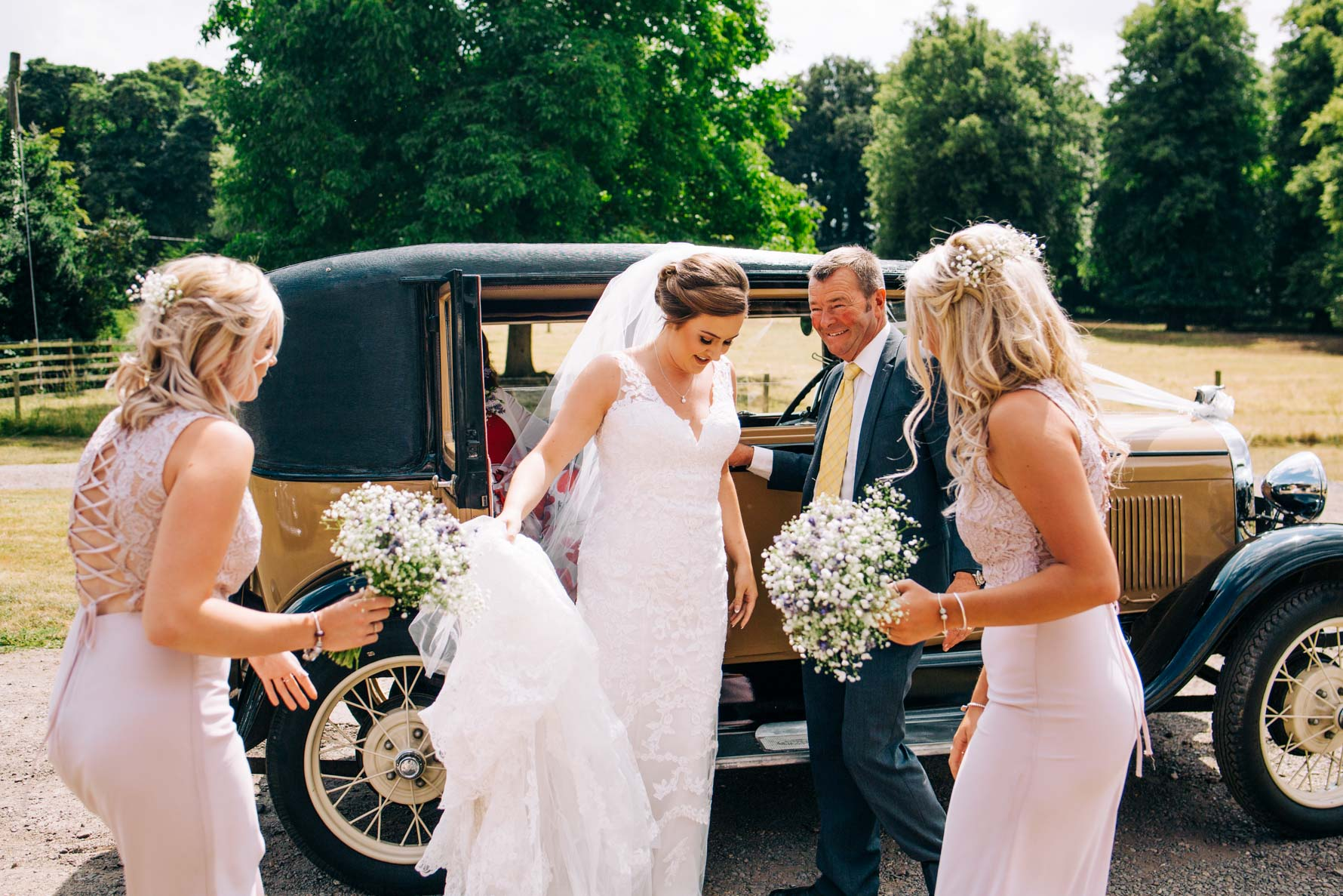 Bride walking out of a wedding car