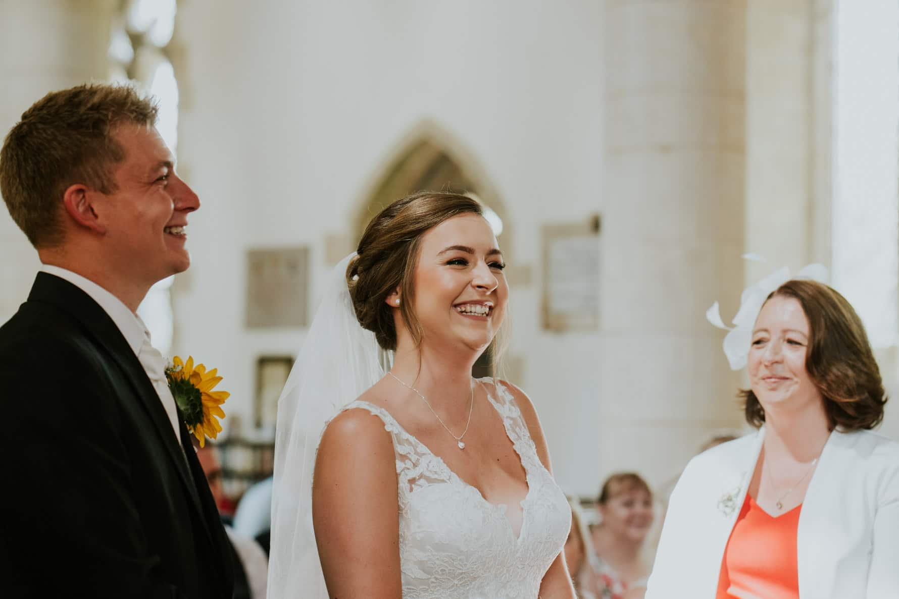 Bride smiling during a wedding ceremony