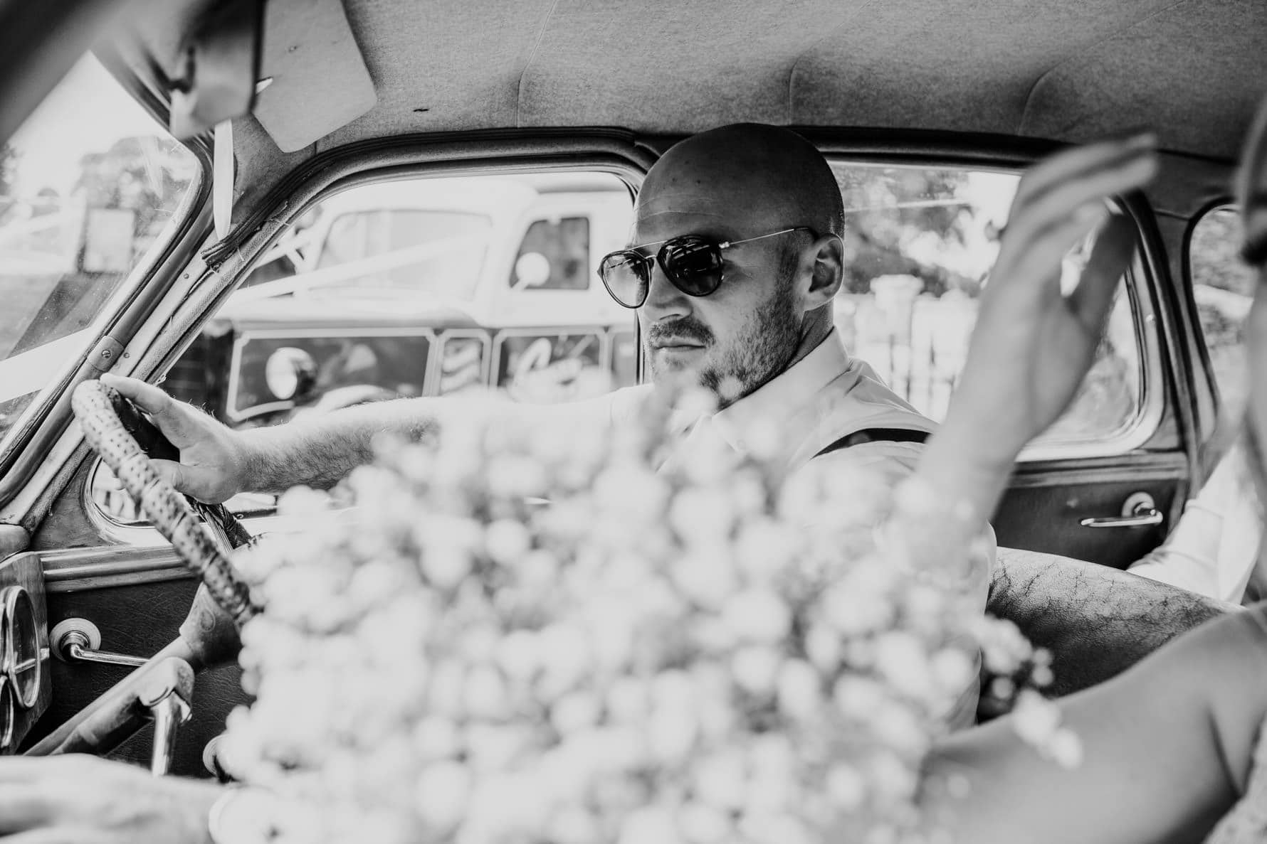 A man driving to a wedding reception