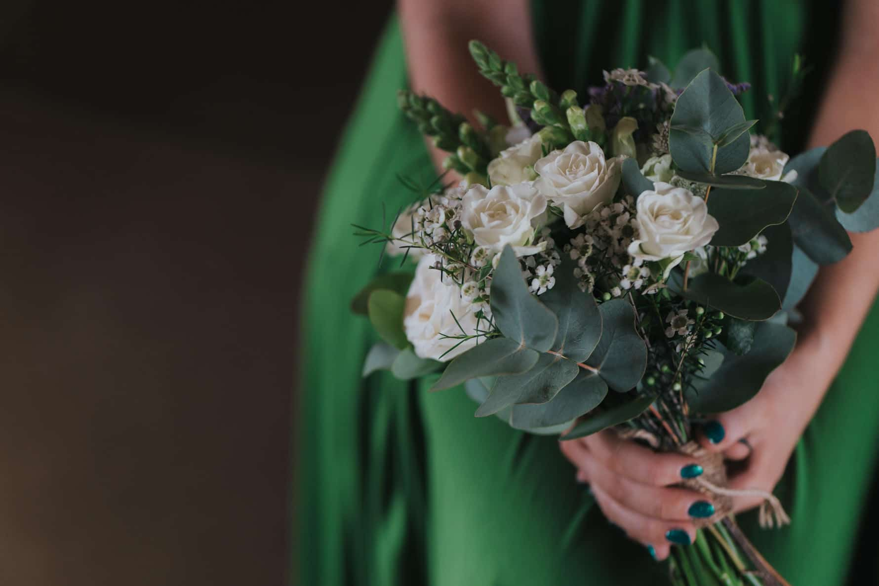 bridesmaid holding wedding flowers