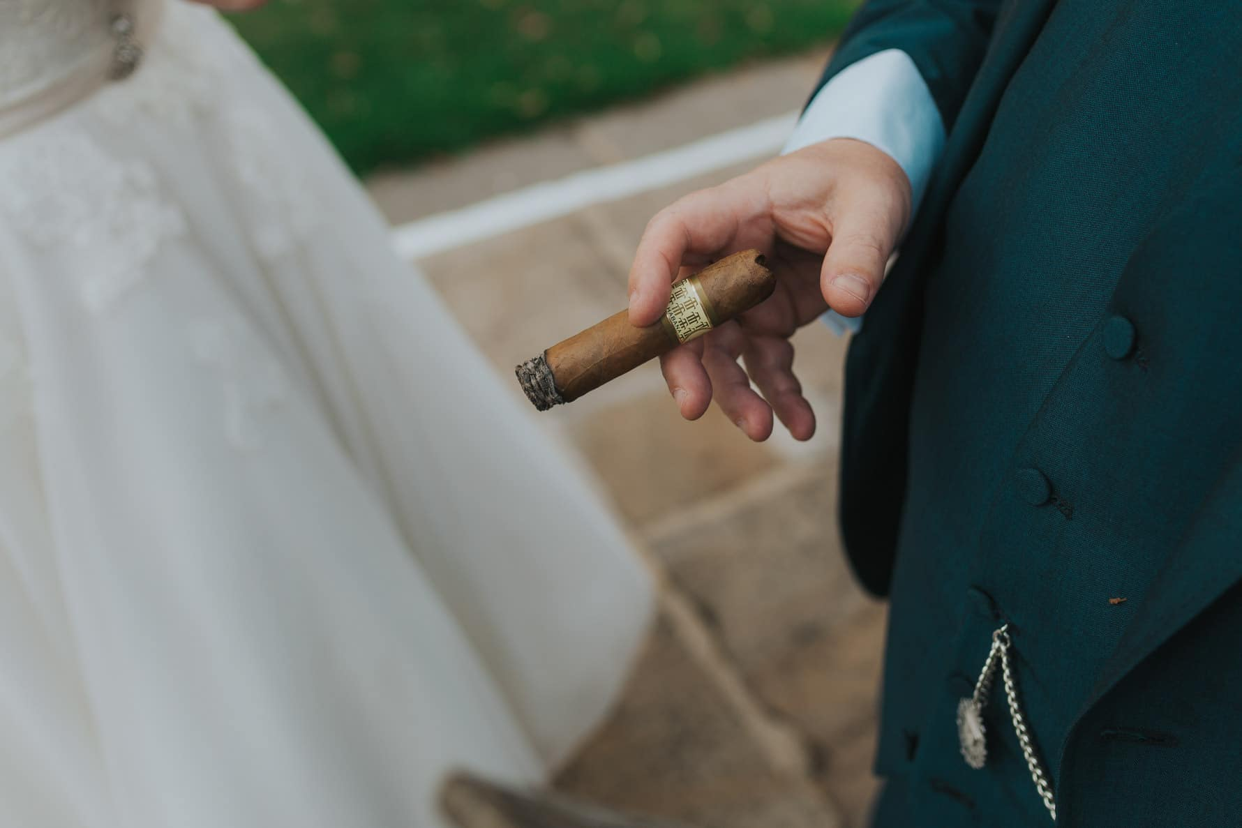 groom's cigar during a wedding reception