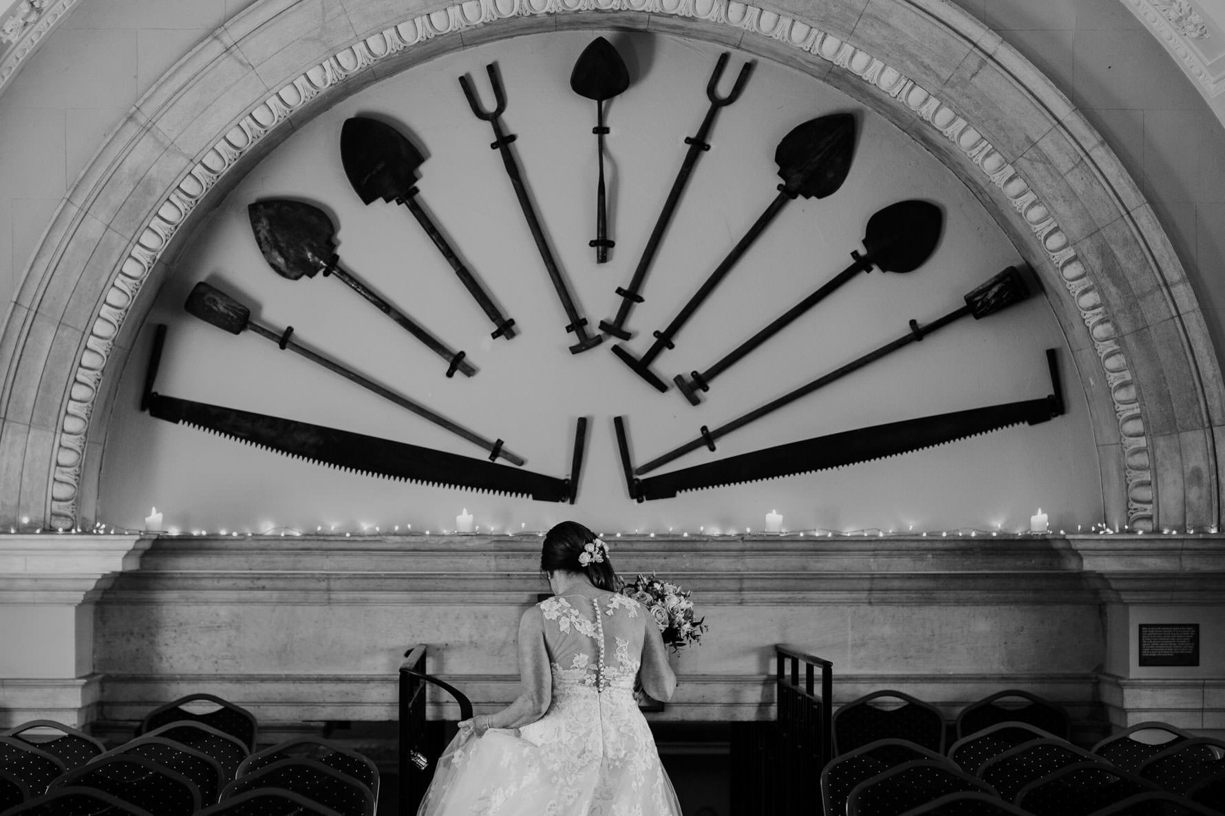 Bride walking down the internal steps of Normanton Church