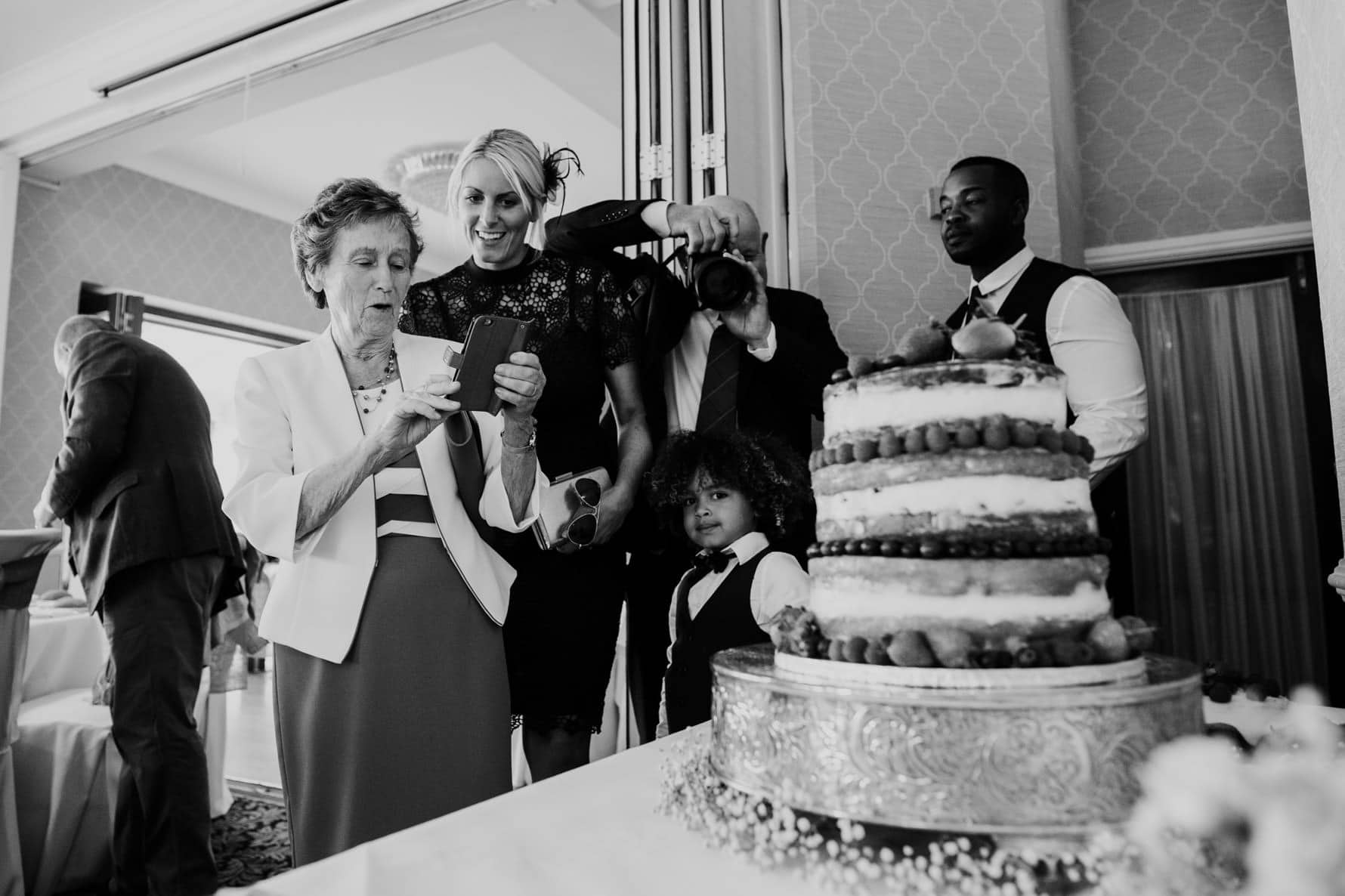 wedding guests admiring the wedding cake