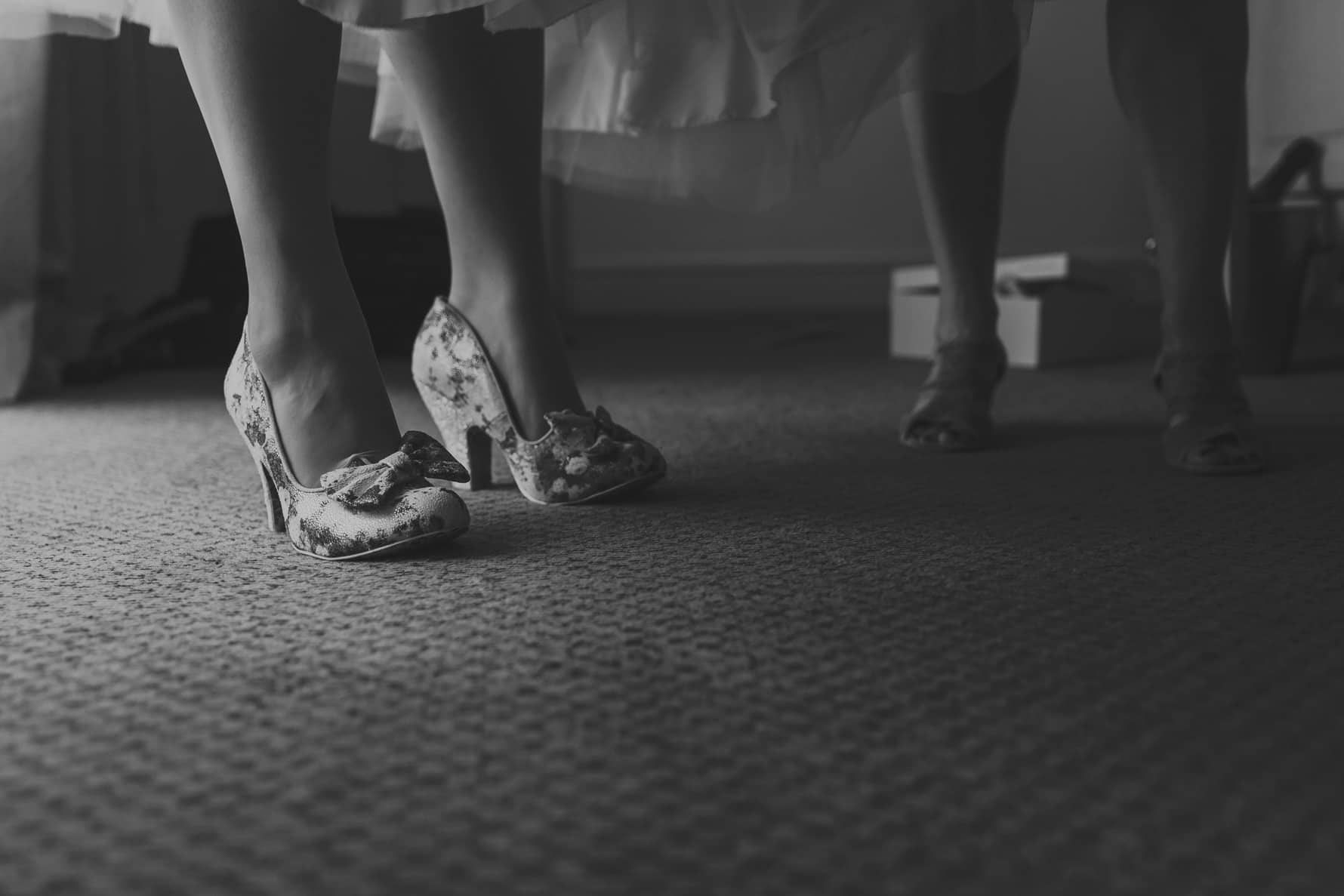 Bride's wedding shoes on the morning of her wedding